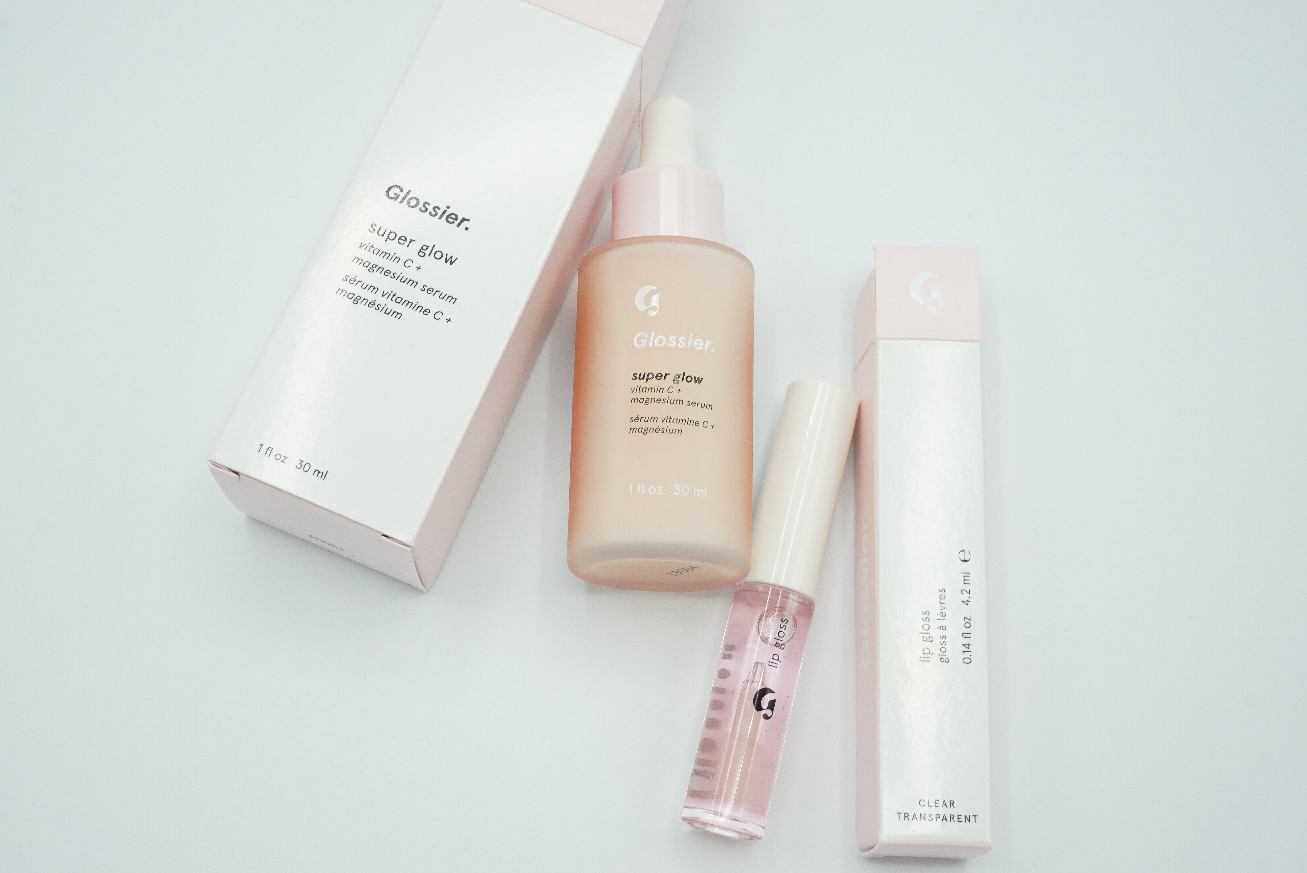 Glossier Products | Glossier Super Glow Vitamin C + Magnesium Serum and Glossier Lipgloss in Clear